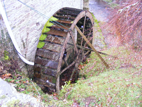 Waterwheel as we found it. Sole plates and buckets rusted through. Wooden shaft rotted away.
